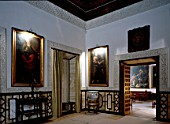 Living room with framed picture and doorway,Casa Pilatos,Sevilla,Spain