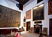 Living room with wall art, fireplace and furniture,Casa Pilatos,Sevilla,Spain