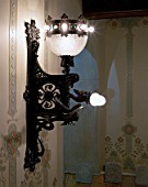 View of a lit wall mount lamp