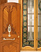 View of an elegant wooden door near a window