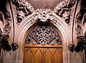 View of wooden doors adorned with carvings
