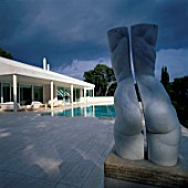 View of a sculpture on a swimming pools deck