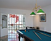 View of a billiards table in a game room