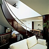 View of a staircase in an eclectic living room