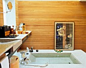 View of a neat bathroom having wooden walls
