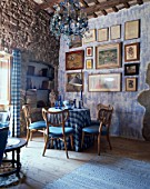 View of a rustic dining room adorned with paintings