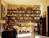 View of well stocked bookshelves in a home office