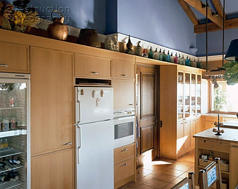 View of wooden cabinets in a kitchen