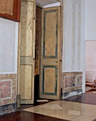 View of an open doorway with old wooden doors