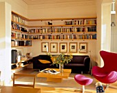 View of an elegant living room with bookshelves
