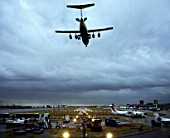 Plane arriving at London City Airport, shot from Connaught Cross, London, UK