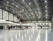 Farnborough airport, Hangars with jets. Designed by 3d reid architects.