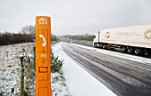 Emergency telephone on hard shoulder of dual carriageway A55, North Wales, UK