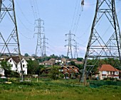 Electromagnetic pollution - electricity pylons next to houses at Southwick, nr Brighton, Sussex