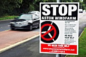 Poster against the opening of Aston windfarm in Cheshire, Weaver Valley, near Northwich, Engand, UK