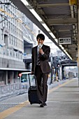 Businessman on railway platform