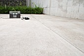 Portable stereo on a concrete floor