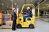 Woman talking to a forklift driver