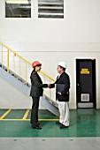 Factory managers shaking hands