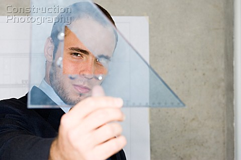 Man holding a set square
