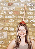 Woman with plunger on her head