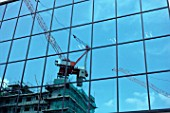 Reflection of construction crane on glass