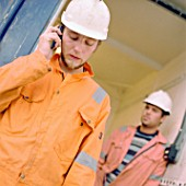 Construction worker using cellular telephone