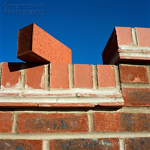 Brick balancing on wall