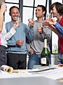 Colleagues toasting success in office