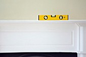 Spirit level on a mantlepiece