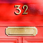 Letter box and number on red door