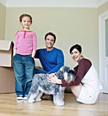 Family and dog in new house