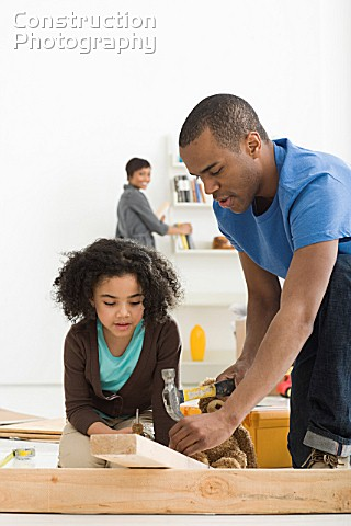 Girl and father building furniture