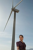 Woman and wind turbine