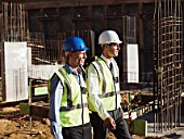Mature men walking on construction site