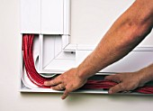 Fixing cables inside Cable Trunking.