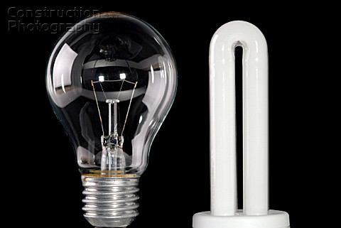 A168 00755 Normal Light Bulb And Energy Saving Bulb Construction Photography