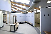 A section of a semi circular changing room in a London sports pavilion