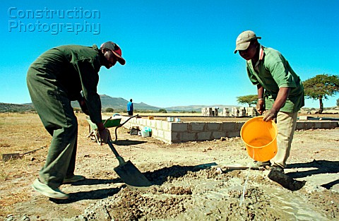 Workmen building schools Msinga KwaZulu Natal South Africa