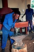 Mochudi Blacksmith working with an anvil, Africa