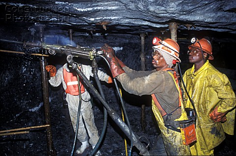 Miners working under ground Johannesburg South Africa