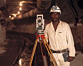 Portrait of an assistant selection surveyor, at the Western Areas Gold Mine, Botsetse, South Africa, 1995.