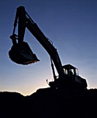 Silhouette of a frontend loader, opencast chrome mining site, South Africa, near Lydenburg. 1995