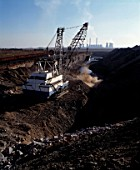 A dragline scrapes away the overburden from the coal seam, Middelburg, South Africa, 1998.