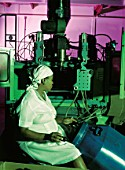 Woman working on assembly line, Africa, 2002
