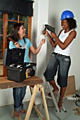 Two girls doing DIY, Durban, Kwazulu Natal, Africa