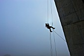 A construction worker abseiling to the next level at the Cape Town Stadium.
