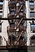 Metal ironwork fire escape stairs, New York City, USA