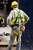 Construction Worker wearing Safety Harness, Helmet and Reflective vest, London, UK