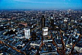 Aerial view of City of London skyline at night, UK